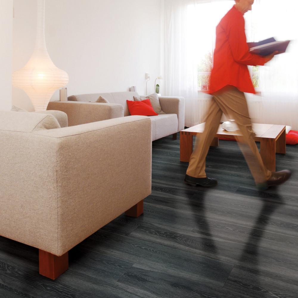 Man walking through living room with file